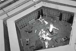 A plane crash is simulated inside the cardboard courtyard of a model Pentagon.