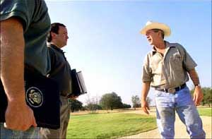 President Bush at his Crawford, Texas, ranch on August 6, 2001. Advisors wait with classified briefings.