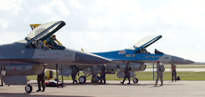 Two F-16s belonging to the 147th Fighter Wing.