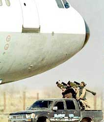 Hijackers threaten the Indian Airlines plane, under Taliban supervision.