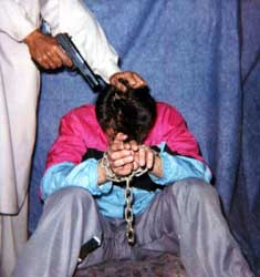 Reporter Daniel Pearl moments before he is killed.