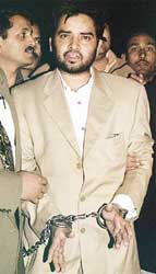 Aftab Ansari in Indian custody shortly after being arrested.