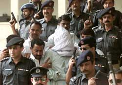 Saeed Sheikh surrounded by police.