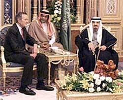 Ex-President Bush Sr. meeting with Saudi Arabia's King Fahd on behalf of the Carlyle Group in 2000.