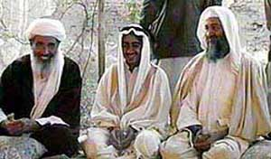 Mohammed bin Laden (center), the son of Osama bin Laden (right),