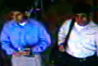 Hijacker brothers Salem (white shirt) and Nawaf Alhazmi (dark shirt) pass through security in Dulles Airport in Washington.