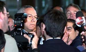 Secretary of State Colin Powell leaves his Lima, Peru hotel after hearing news of the attacks.