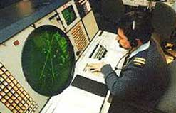 A soldier monitors a NORAD radar screen.