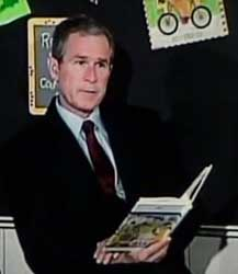 Bush continues to read the goat story.