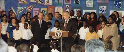 President Bush begins speaking at 9:30 a.m. in the library of Booker Elementary School. 