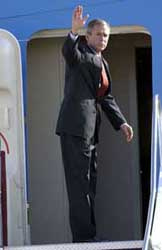 Bush boards Air Force One in Sarasota, Florida, waving to people below as if the day were like any other.