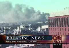 A television broadcast falsely describes smoke coming from Washington Mall instead of its true source, the Pentagon.