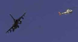A fighter and helicopter both fly directly above the Pentagon on 9/11 on the morning of 9/11. Exact time is unknown.