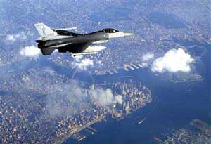 An F-16 flies over New York City on September 12, 2001. Smoke is still rising from the World Trade Center.