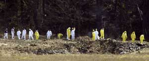 The Flight 93 crater later in the morning. Notice the destruction of the airplane is nearly total.