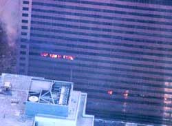 Several small fires burn inside World Trade Center Building 7.