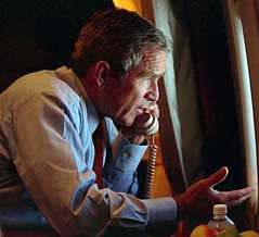 This photo of Bush speaking to Cheney shortly after leaving Offutt will later be used for Republican fundraising purposes.