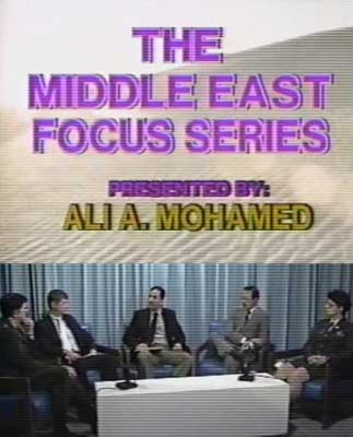 Ali Mohamed, in one of the US military videos he helped create. In the lower picture, he is in the center, chairing a discussion on the Middle East with other US army officers.
