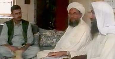 Baker Atyani, reporter for the Middle East Broadcasting Company, sits with Ayman al-Zawahiri and bin Laden.