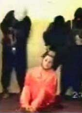 A video still of Nick Berg being tormented by his captors in Iraq.