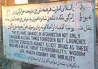 "A sign put up by the Taliban reads: ""The Islamic Emirate of Afghanistan not only engenders illegal things forbidden but launches effective struggles against illicit drugs as these drugs are a great threat to personality, wisdom, life, health, economy, and morality."""