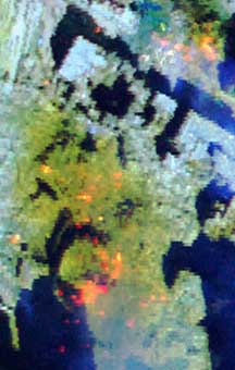 Thermal hot spots detected by satellite on September 16, 2001. Red and orange indicate the hottest locations. The World Trade Center Twin Towers footprint is in the lower center and the center of World Trade Center Building 7 is in the upper right.