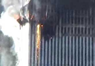 Molten metal pouring out of the side of the World Trade Center.