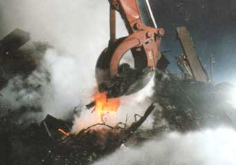 A chunk of hot metal being removed from the North Tower rubble about eight weeks after 9/11.