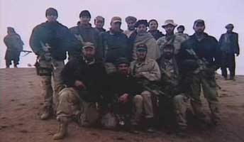 Members of the US Fifth Special Forces Group pose with future Afghan president Hamid Karzai, whom they are protecting.