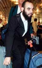 Mzoudi in an airport in Hanover, Germany, on June 21, 2005 as he returns to Morocco.