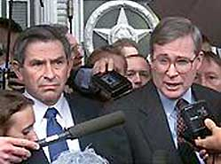 Deputy National Security Advisor Stephen Hadley (R) and Deputy Secretary of Defense Paul Wolfowitz (L) speak to reporters in Moscow after taking part in negotiations with Russia regarding an anti-ballistic missile shield on May 11, 2001.