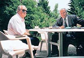 Ahmad Huber (left) with Jean Marie Le Pen (right), at Christian Cambuzats spa in Switzerland.