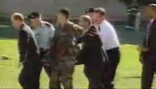 Rumsfeld show on a video broadcast on CNN helping carry a stretcher shortly after the Pentagon attack. He is in the center of the picture, wearing a dark jacket.