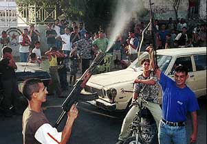 Men in the Palestiani Shatila refugee camp, Lebanon, celebrating the 9/11 attacks.