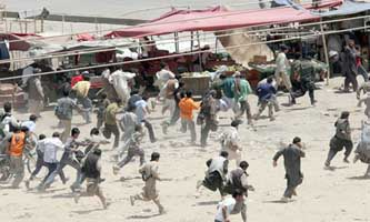 Protesters in Kabul run from Afghan police gunshots.