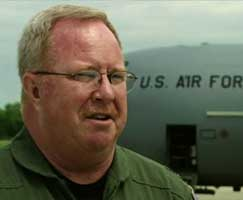 Lt. Col. Steve O'Brien standing in front of a C-130.
