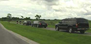 Bush's motorcade on its way to the Sarasota airport.