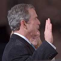 George W. Bush taking the oath of office.