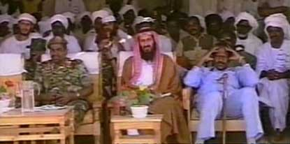 Bin Laden (center) being feted by Sudanese leaders.