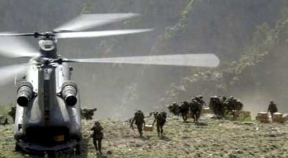 US Special Forces unloading equipment in the Tora Bora region.