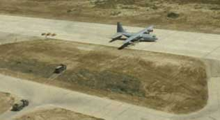 Apparently, this surveillance photo of a C-130 transport plane from the United Arab Emirates plays a key role in the decision not to strike at bin Laden.