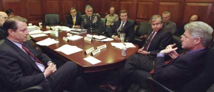 Al Gore (close left) and Bill Clinton (close right), in a Small Group meeting. Sitting at the table between them, from left to right, are George Tenet, Henry Shelton, William Cohen, and Sandy Berger.
