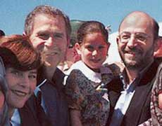 Laura and George W. Bush on the left, Sami al-Arian on the right.