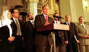 President Bush in front of the Islamic Center on September 17, 2001. Alamoudi is on the far right.