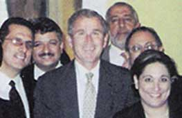 Bush, center, and some of the Muslim activists meeting with him in Austin, Texas. Alamoudi is standing over his left shoulder.
