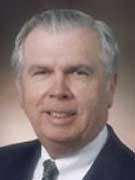 W. Gene Corley.