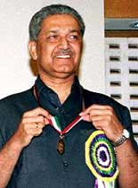 A. Q. Khan receiving a medal.