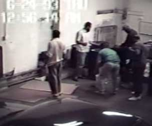 Informant Emad Salem, pictured bent over in a green shirt, enables the FBI to take surveillance footage like this of the plotters making a bomb.