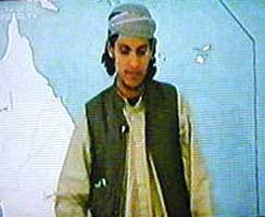 Abdulaziz Alomari filmed speaking in Afghanistan in early 2001. He stands in front of a large map of the world.