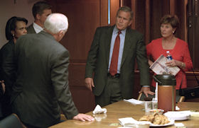 President Bush and Laura Bush talking with Dick Cheney and Condoleezza Rice in the Presidential Emergency Operations Center.
